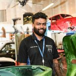 Sachit Shah with car body parts
